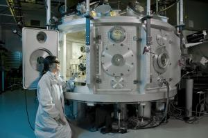 Researcher Hui Chen sets up an experiment in the Titan target chamber at the Jupiter laser facility